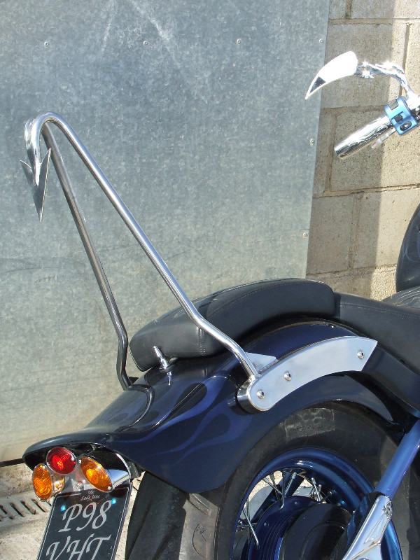 One-Off Devil's Tail SS sissy bar on Yamaha Dragstar custom. Candy Blue over Silver Powdercoated wheels with SS spokes. Custom paint by our partner DW Automotive.